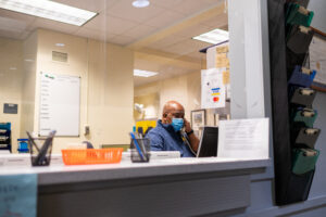 University Health System staff answering phone